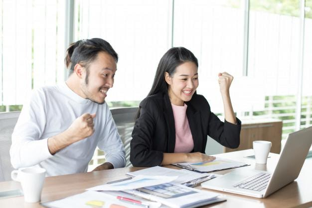 Asian man working project with woman at office place | Premium Photo